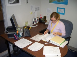 Amelia Self works at her desk at the IRC.