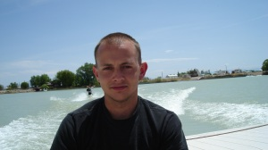 Brett Perfili, a journalism student at the University of Utah, riding in a boat at his favorite getaway spot in Delta, Utah.