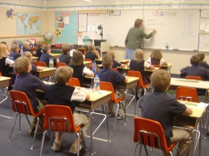 A third-grade class at the American Preparatory Academy sit mostly at attention. In August 2009, APA will open a second campus in West Valley City aimed at helping refugee children.