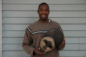 Issa Moursal holds a traditional mask from Niger. Photo courtesy of Issa Moursal.