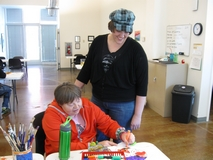 Katelyn Johnson, right helps a client at TURN City Center for the Arts, located at 511 W. 200 South in Salt Lake City.
