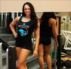 Kristy Jo Hunt poses in the gym after working with a client.