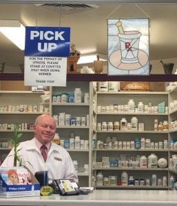 Lloyd Thomas stands at his pharmacy in Roy Winegars.