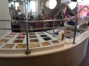 The display of toppings allows customers to choose however much they want and whatever they want.