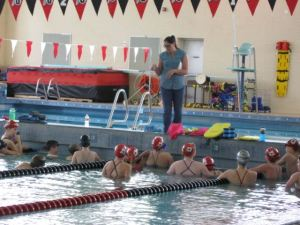 """""""I coach because it's really fun, I  like to help my swimmers reach their goals and watch them grow."""" says Coach Amy Barefield"""