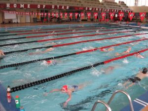 Swim Utah manages to run an organized practice in a rather crowded pool.