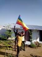 LGBT refugees at Kakuma Camp proudly display the LGBT flag.