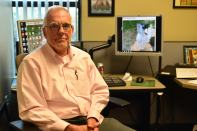 """Gerald in his office with a comical screensaver, """"It's important to laugh,"""" Brown said."""