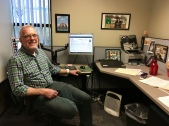 Gerald Brown sits at his desk at the Utah Refugee Education & Training Center.