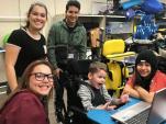 Jordan High volunteers sharing in the joy of their classmate reaching new goals.